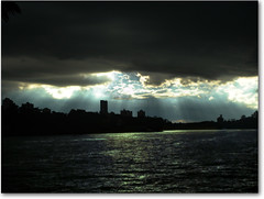 Sky of Gold and Lead, Light and Darkness (AnnuskA  - AnnA Theodora) Tags: light brazil lake paraná brasil gold cityscape darkness dramatic sunrays lead londrina myhometown 3000v120f thisisnothdr darkheavyclouds thoughyoucantseeititwasraining