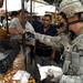 U.S. Soldier Pays an Iraqi Vendor