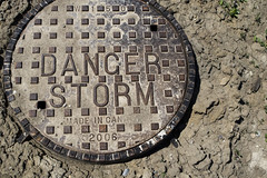 Danger Storm (Scott Shingler Photography) Tags: toronto storm metal danger circle bumpy dirt round manhole sewer doorsopen