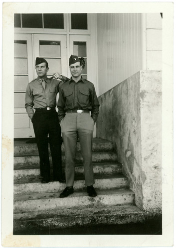 two uniformed boys with wet pants