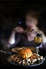 Self Portrait with Harvest Feast (Jackie Alpers) Tags: autumn portrait food woman selfportrait night feast self turkey pumpkin table blurry alone sitting wine eating leg nuts harvest www celebration turkeyleg gluttony foodphotography jackiealpers