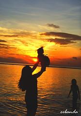 A mother from sunrise to sunset (ERIC OEBANDA) Tags: family child parent pinoy ih pinoykid oebanda