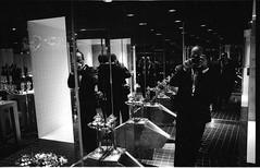 Self-portrait in posh toilet. Manhattan, 2003 (finitor) Tags: bw selfportrait mirrors tuxedo urinals neopan3200