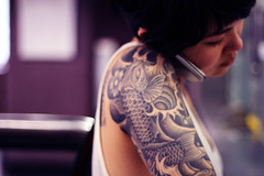 IMG_3340 (shotsbyjas) Tags: woman black girl mobile tattoo ink canon 50mm grey phone arm bokeh cell f18 sleeve 40d
