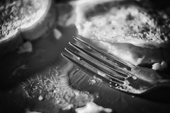 Eggs, Toast, and a Fork (Judd McCullum) Tags: light bw white inspiration black macro film breakfast contrast apartment toast grain fork eggs magnification