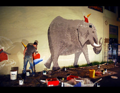 Painting an elephant... (QuEpAsA Boy!) Tags: man night gnome mural paint downtown artist tucson workinprogress rialtotheatre painter buckets gnomes eleplants
