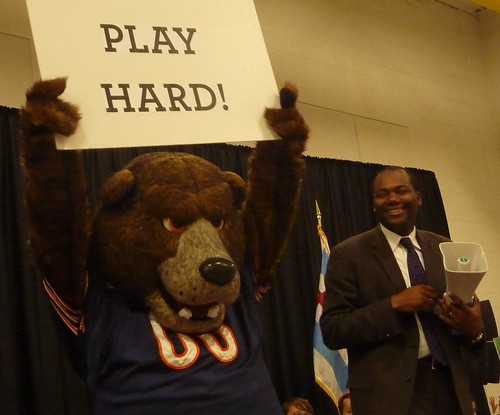Chicago Bears mascot Staley the Bear helps CPS CEO Jean-Claude Brizard lead a cheer.