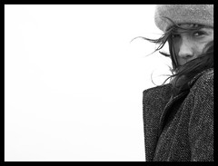 As the wind blows (Sator Arepo) Tags: portrait blackandwhite bw white black eye look hair reflex wind coat olympus negativespace highkey blows zuiko e500 uro abigfave 50mmmacroed retofz080624