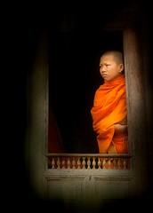 Young monk in Luang Prabang. (Maurizio Blasetti) Tags: orange photoshop nikon asia monk d200 laos luangprabang theunforgettablepictures