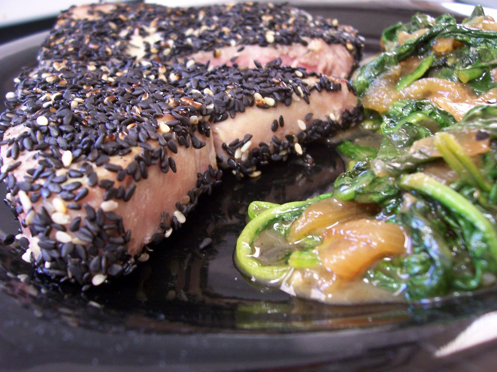Seared sesame crusted yellowfin tuna with miso glazed spinach and onions