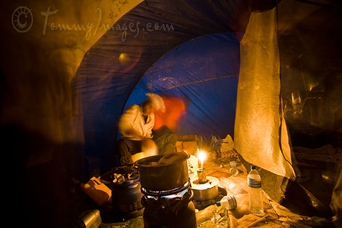 Cooking by candlelight in a tent