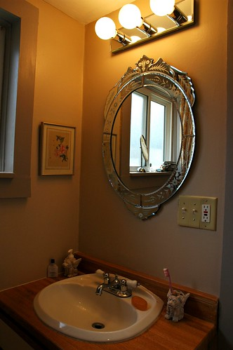 Renovation: New 1930's style mirror and mirrored lights, with fresh coat of paper bag brown paint, Seattle, Washington, USA