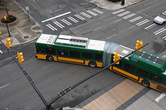 20050107_8942...Articulated bus, shot from above (listorama) Tags: bus washington downtown parkinggarage fromabove intersection renton articulated crosswalks transitcenter
