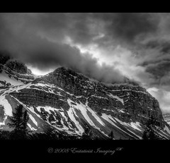 Fury of the Heights (ecstaticist) Tags: travel light sky blackandwhite bw cliff cloud mountain snow storm tree weather wall photoshop rockies rocky glacier casio alberta massive majestic hdr majesty photomatix supershot ecstaticist exf1 ecstaticistimaging