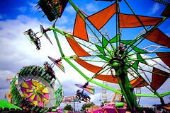 At The Oregon State Fair (Celine Chamberlin) Tags: carnival blue red sky clouds oregon ride statefair fair salem oregonstatefair