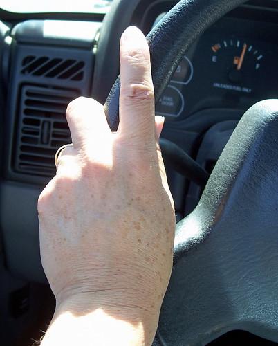 Hand on steering wheel by cheerytomato.