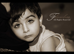In his eyes,,, I live  (Flawless ) Tags: boy portrait bw baby love beautiful canon kid amazing eyes child sad sweet soul expressive arabian embrace goldenglobe