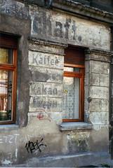 Berlin - Faded Shops #3 (picture_addicted) Tags: berlin sign d50 germany painting lost deutschland nikon capital hauptstadt 1999 faded ddr past gdr prenzlauerberg eastberlin fassade vergangenheit ostberlin altbau pictureaddicted inschriften prenz'lberg