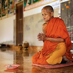 Living a spiritual life (Bn) Tags: orange topf50 nirvana monk laos enlightenment topf100 colori enlightened buddhistmonks theravada 100faves 50fav