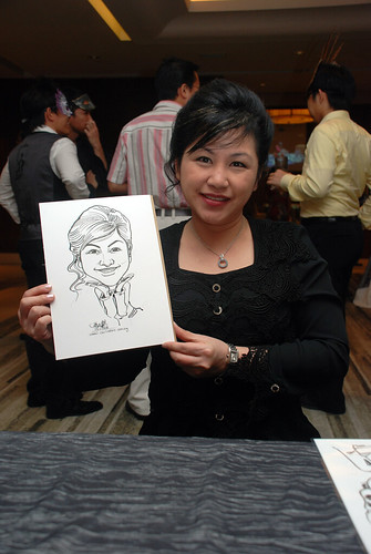 Caricature live sketching for Ezra Holdings 2
