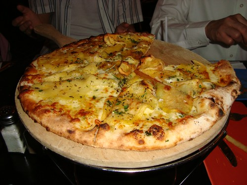 Navona - sliced potato, mozzarella, rosemary & olive oil