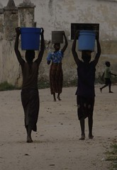 Mozambique Ladies Carrying Water
