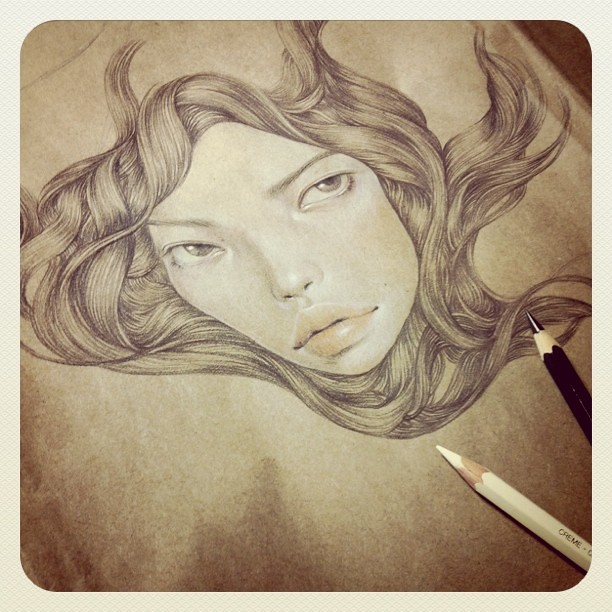 Drawing on used scrap packing paper.