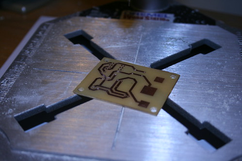 Making PCBs at home, Attempt 2: Toner removed and holes drilled with Dremel