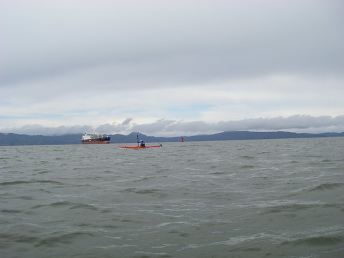 kayaker and ship