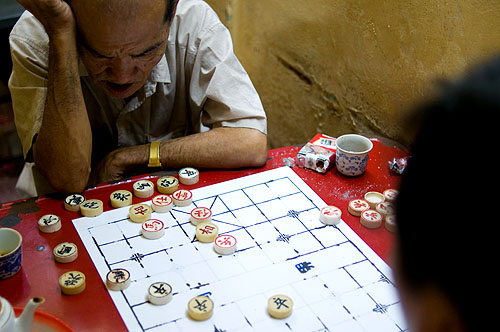Playing mah jongg in Bangkok's Chinatown