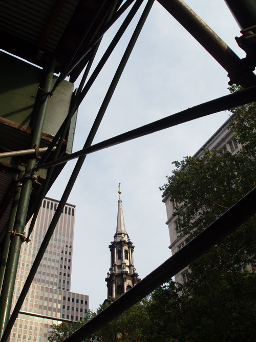steeple of the Trinity Church as seen through nearby scaffolding, Manhattan, NYC