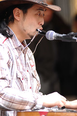 george kamikawa (alvin hermanto) Tags: musician music japanese george nikon singing guitar country d2x nikkor bourkestreet busking f28 harmonica 80200mm kamikawa lapguitar
