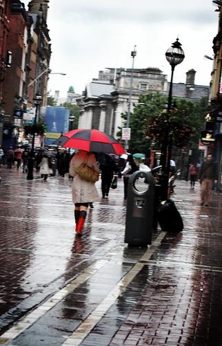 Black and red on rainy Grafton Street