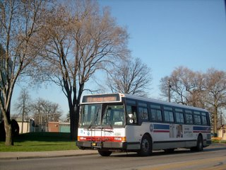 Eastbound CTA Route # 77 Belmont Avenue bus departing the west terminal. River Grove Illinois. April 2007.