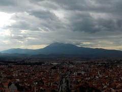 Prizren, Kosovo (FriaLOve) Tags: city morning houses light red sky people white house mountain clouds dark view prizren kosova frialove