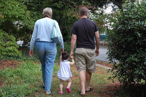 Walking between Daddy and Grandma