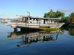 We're going to need a better boat (dachalan) Tags: boat asia southeastasia underwater scuba diving malaysia borneo thumbsup sabah celebessea semporna nikoncoolpixp1 dachalan photofaceoffwinner sulawesisea pfogold tunsakaranmarinepark