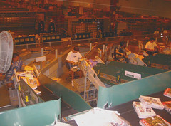 20030926 - USPS - SPBS (Small Parcel Bundle Sorter) - view from above - workers keying in ZIP codes - 100-0009 (Rev. Xanatos Satanicos Bombasticos (ClintJCL)) Tags: 2003 virginia hardware workers mail business worker usps 200309 20030926 merrifield unitedstatespostalservice keying spbs smallparcelbundlesorterspbs smallparcelbundlesorter