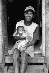 Brian Carlson (www.briancarlsonphoto.com) Tags: poverty portrait blackandwhite bw baby film 35mm child carlson philippines poor documentary manila humanitarian ngo nonprofit manilaphilippines briancarlson briancarlson