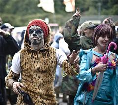 Raindance (Jane Hoskyn) Tags: people music sunglasses festival umbrella glasses dance costume outfit dancers dancing crowd livemusic strangers 85mm dancer isleofwight f18 fancydress brolly bestival leopardskin sundaybest