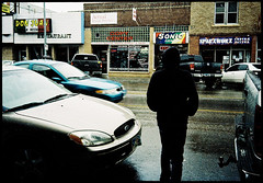 (danielneemann.com) Tags: street portrait building film rain silhouette 35mm point alley shiny shoot shine border ps human rainy casper mysterious pointandshoot wyoming anonymous portra s100 noidentity
