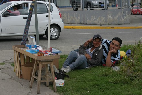 Happy road side vendors. Cuenca suburb, Ecuador.