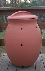 my new compost bin (plastic made to look like terra cotta)
