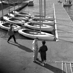 1957-20 01 (ndpa / s. lundeen, archivist) Tags: nick dewolf nickdewolf misc miscellaneous blackwhite photographbynickdewolf massachusetts boston charles river esplanade community boating boathouse boat sailboat boats sailboats pier dock local people man woman women shadows bw 1957 1950s film 6x6 mediumformat monochrome blackandwhite tlr