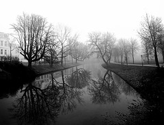 Misty Lepelenburg, Utrecht - black & white (lambertwm) Tags: park trees bw mist water misty fog contrast reflections canal blackwhite haze bom