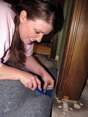 Karen cutting the underlament