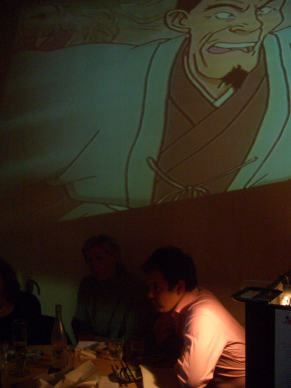 Jamon Sushi with anime projected on wall