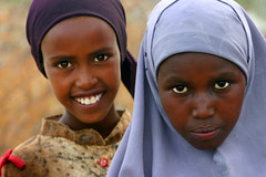 Sunny and Serious Awbare Girls (LindsayStark) Tags: africa travel portrait girl children war child refugee hijab conflict somali ethiopia humanrights humanitarian somalia displaced refugeecamp humanitarianaid emergencyrelief waraffected conflictaffected jijiga awbare