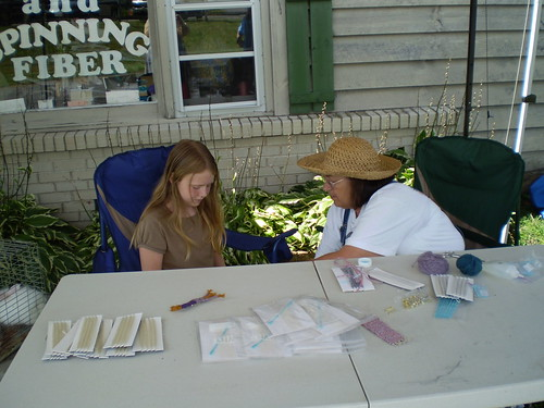Jane teaching weaving at kids' tent