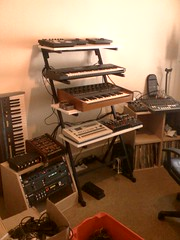 Progress on the North wall. (ArboriaAuralist) Tags: analog studio 2000 synth roland korg analogue 707 wedge synthesizer moog juno lexicon drummachine alesis transcendent gearporn moogerfooger mxr poly61 tr707 gearpron alphajuno powertran